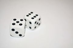 Two white dice isolated on white. Background Royalty Free Stock Photography