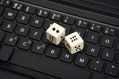 Two White Dice rolled On Keyboard Close Up Stock Images