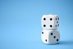 Two white dices on blue background. Two big white dices on blue background Royalty Free Stock Photo