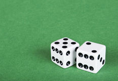 Two white dices on green Stock Image