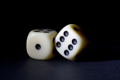 Two White Dices Isolated on Black  Stock Photos