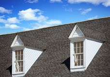 Two White Dormers on Grey Shingle Roof stock image