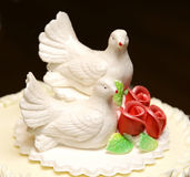 Two white doves on wedding cake bride and groom Royalty Free Stock Image
