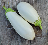 Two white eggplants closeup on a old wooden table. Two white eggplants closeup on a old gray wooden table Stock Photo