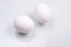 Two white eggs. In the studio Royalty Free Stock Image