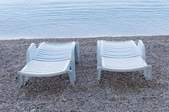 Two white empty deck chair Royalty Free Stock Photo