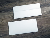 Two white envelopes. Two white blank envelopes on wooden background. Front and back side stock images