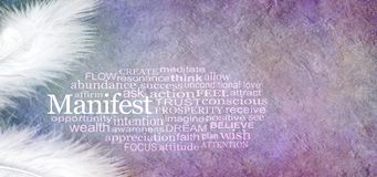 Manifest Abundance Word Cloud Banner. Two white feathers and a MANIFEST word cloud against a rustic purple subtle coloured stone effect background with copy stock photography