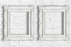 Two white frame. On brick wall Stock Image