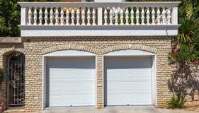 Two white garage doors