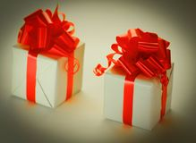 Two white gift box with red ribbon .isolated on white Stock Photography