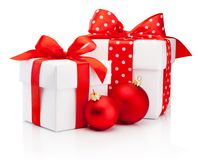 Two white gift box tied red ribbon bow and Christmas baubles Iso stock photography