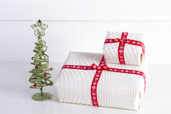 Two white gift boxes with polka dots  a red ribbon. Royalty Free Stock Image