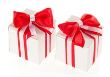 Two white gift boxes with a red bow Stock Photo