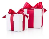 Two white gift boxes tied burgundy ribbon bow on white. Two white gift boxes tied burgundy ribbon bow on a white background stock image