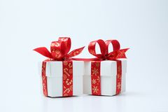 White gift box tied with Christmas theme red ribbon royalty free stock images