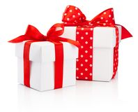 Two white gift boxes tied red ribbon bow Isolated on white background. Two white gift boxes tied red ribbon bow Isolated on a white background royalty free stock image