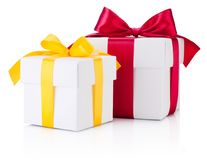 Two white gift boxes tied yellow and burgundy ribbon bow Isolate. D on a white background stock photography