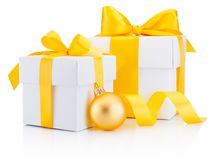 Two white gift boxes tied yellow ribbon bow and bauble Isolated Royalty Free Stock Photos