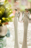 Two white , glittery angel Stock Images