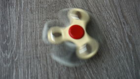 Two white hand spinner spinning on grey background or fidget spinners stock video footage