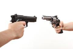 Two white hands hold gun Stock Photos