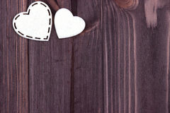 Two white hearts of felt on a brown wooden background. Valentine Day. Greeting Card. Wedding. Stock Images