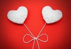 Two white hearts made from wool Stock Images