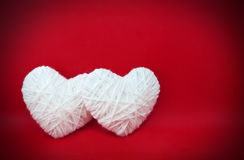 Two white hearts made from wool Royalty Free Stock Image