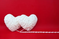 Two white hearts made from wool Royalty Free Stock Photos