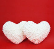 Two white hearts made from wool Stock Image