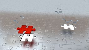Two White Holes in Puzzle Pieces floor with One Red Piece and One grey above all other Royalty Free Stock Photo