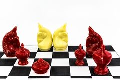 Two of white horse Chess charactor around with red enemy royalty free stock images