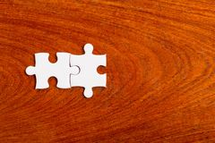 Two white jigsaws are placed on wooden boards., Joint Business C. Oncepts stock photos