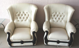 Two white leather armchairs. In the hall Stock Images