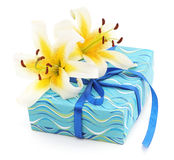 Two white lilies and present. stock photography