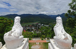 Two white lions statue at Wat Phra That Doi Kong Mu,Mae Hong Son, Northern Thailand. Back view of two white lions statue at Wat Phra That Doi Kong Mu with aerial Royalty Free Stock Photography