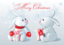 Two white little rabbit. Two rabbit with gifts, in the winter forest Stock Images