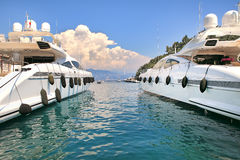 Two white luxury yachts on Mediterranean sea. Stock Photos