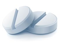 Two white medical pills Stock Photography