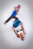 Two white men throwing balls stock photography
