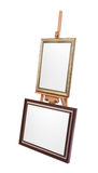 Two white painter canvas in frame on wooden easel isolated Stock Image