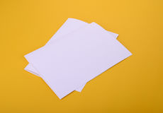 Two white paper bifold brochure mockup on yellow background Stock Images