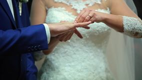 Two White People Groom and Bride Exchange Wedding Rings.  stock video