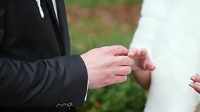 Two white people groom and bride exchange wedding rings.  stock footage