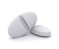 Two white pills Royalty Free Stock Photos