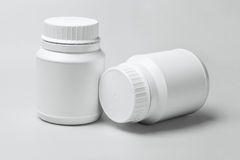 Two White Plastic Containers royalty free stock photography
