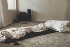 Two White Rectangular Pillows With White Blanket on Floor Stock Images