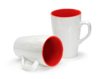 Two white and red mugs isolated on white background Stock Photo