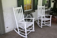 Two white rocking chairs on the porch, royalty free stock photo
